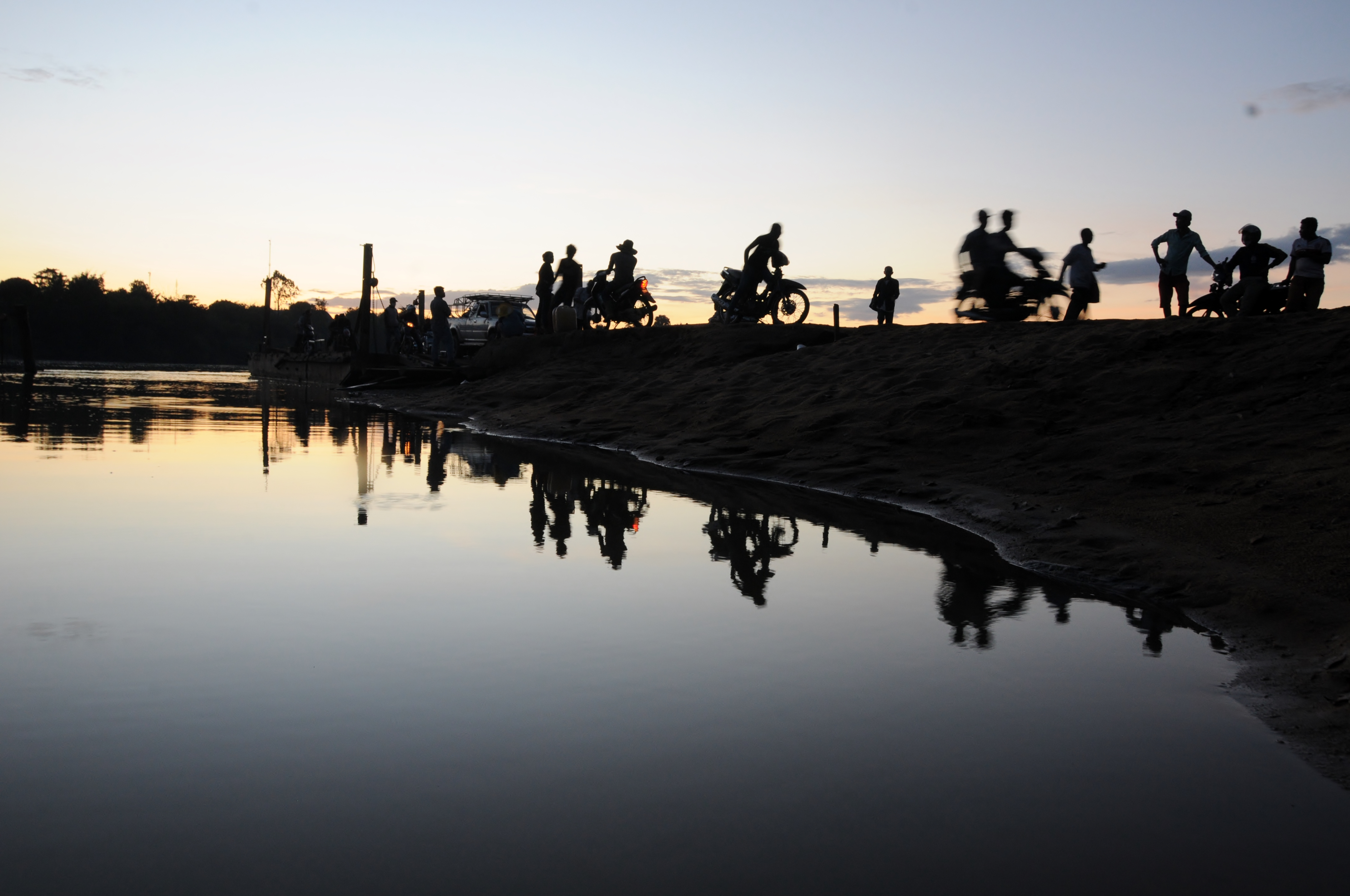 People crossing the river in the evening, Cambodia